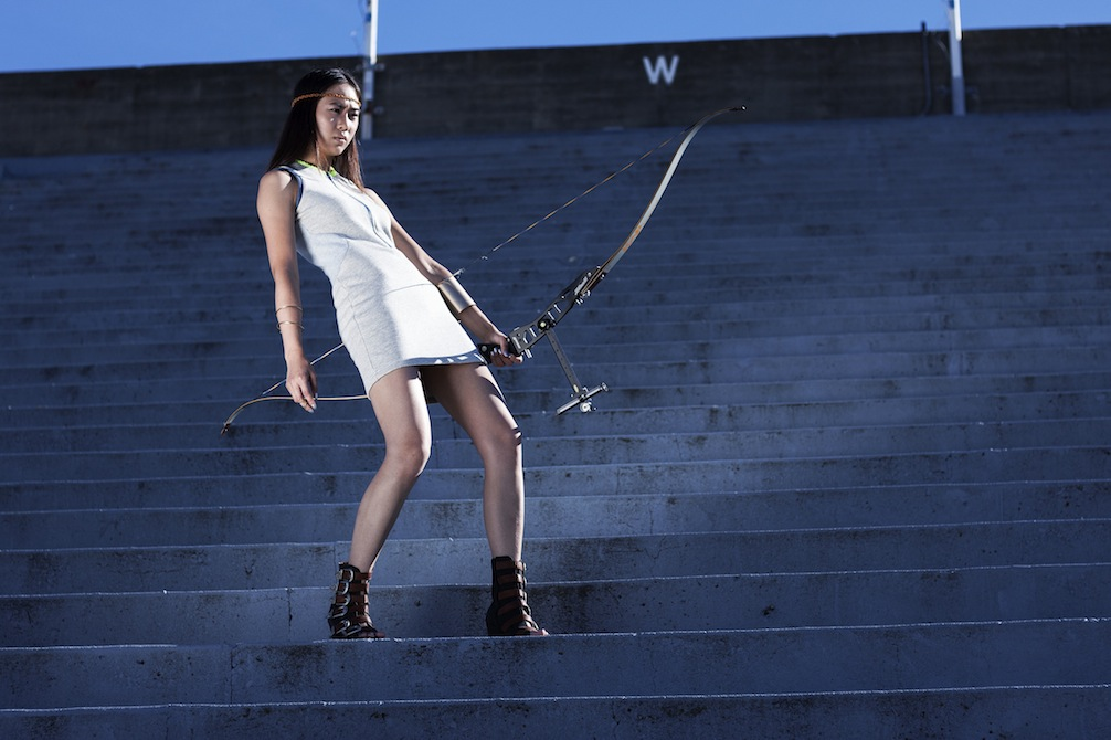 Dress: Acrimony; Headband, Bracelet, Cuff: Sway; Shoes: Stylist's own; Archery Bow: Model's own